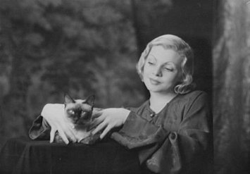 Unknown Woman with a Siamese Cat