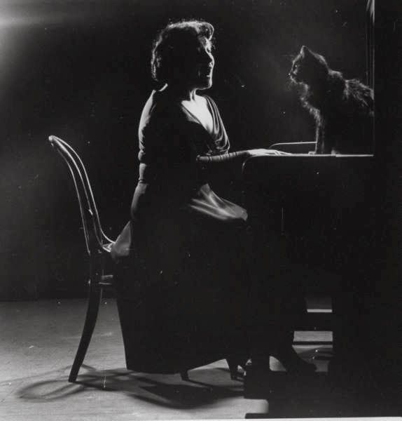Blackie Sitting with Opera Singer Jennie Tourel, black cats