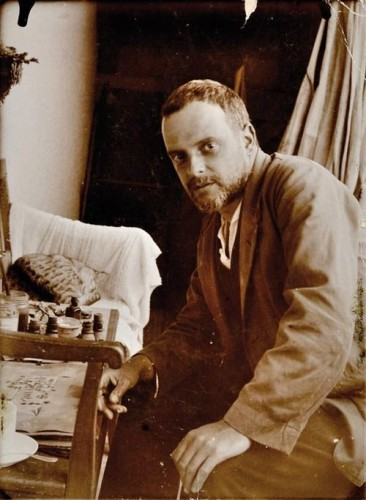 Paul Klee with his cat Skunk (Fripouille), in front of the oil drawing All Souls Picture (Possenhofen, Germany 1921)by Felix Klee, son of Paul and Lily Klee
