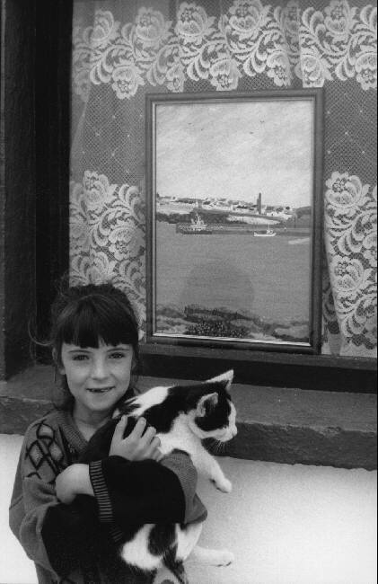Girl and Black and White Cat, Martine Franck