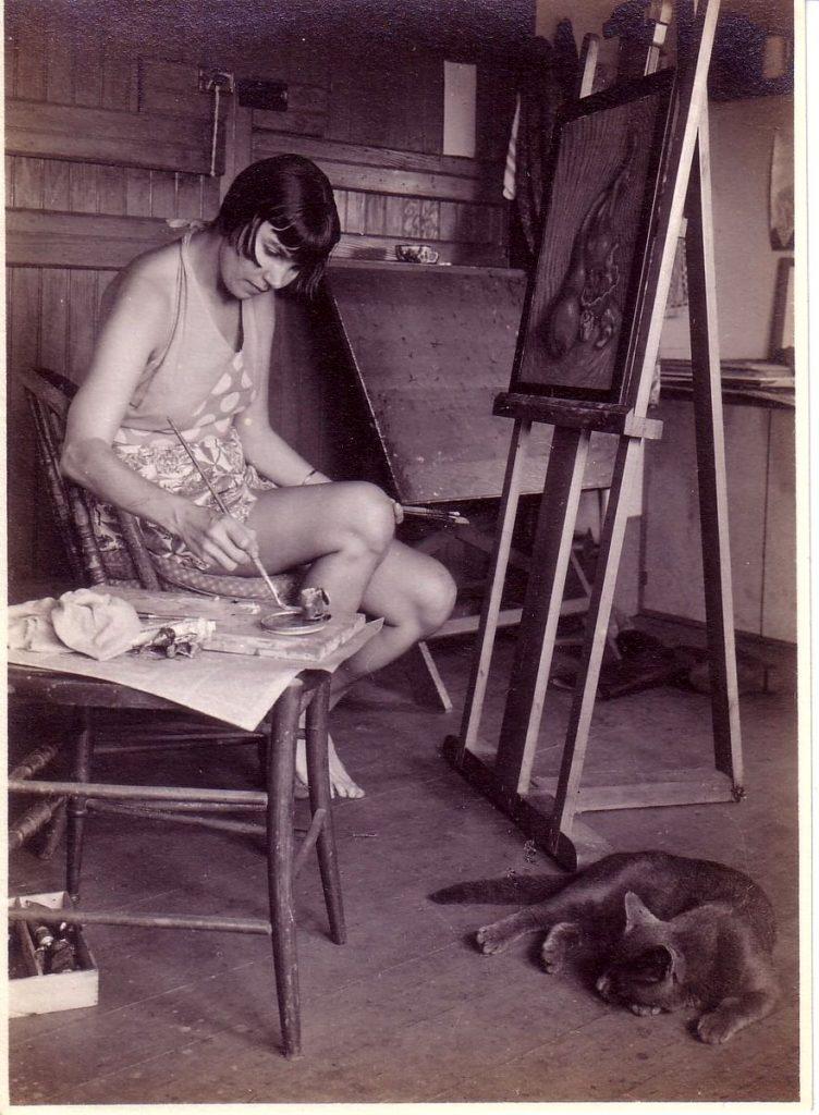 Wanda Gag in her studio with cat